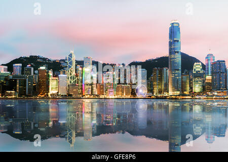 Beautiful Hong Kong, China skyline from across Victoria Harbor.sunset time - Stock Photo