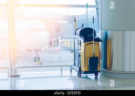 mop bucket and set of cleaning equipment in the airport - Stock Photo