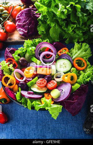 Spring salad with lots of vegetables and full of color. - Stock Photo