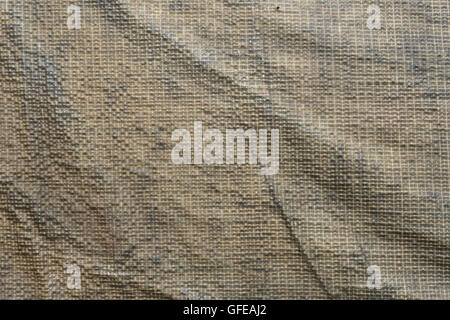 Window material of an old canvas army field tent showing detailed texture of the polyester mesh & Window material of an old canvas army field tent showing detailed ...