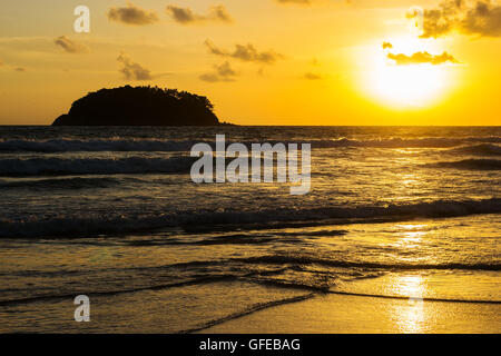 Beach sunset of the sea with sky and cloud in twilight over light the sun and dark tone - Stock Photo