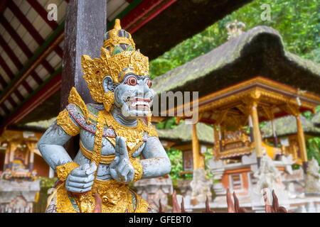 God statue at Pura Gunung Kawi Temple, Bali, Indonesia - Stock Photo