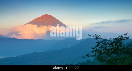 Gunung Agung Volcano at sunset, Bali, Indonesiawilderness - Stock Photo