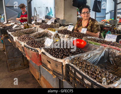 Olives for sale at the food market in the bazaar district. Korca, South eastern Albania. - Stock Photo