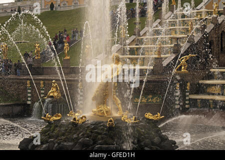 Sculptures and fountains, Peterhof Grand Palace, St Petersburg, Russia. Russian gold golden gold leaf gilt gods - Stock Photo