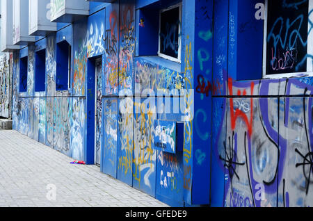 ODESSA, UKRAINE - MARCH 3, 2016:urban street abstract art paintings on old blue abandoned building of old Odessa - Stock Photo