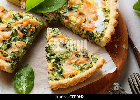 rustic salmon quiche with spinach, food - Stock Photo