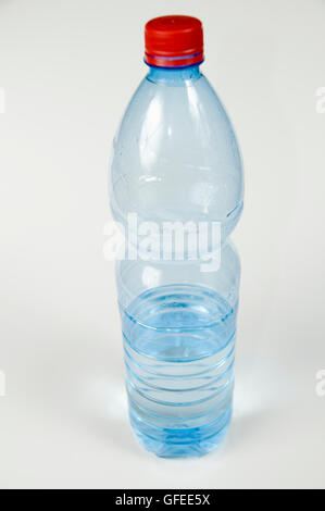 Cutout of a Plastic Bottle of Mineral Water on white background - Stock Photo