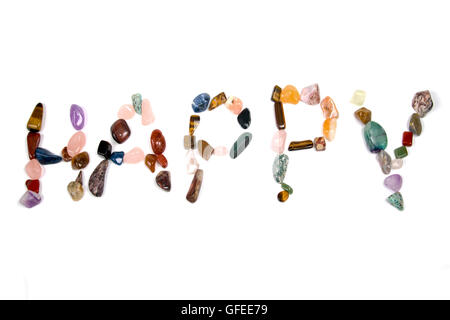 New age crystals and gemstones spelling out Happy - Stock Photo