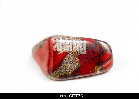 Cutout of a Brecciated Jasper gemstone on white background - Stock Photo