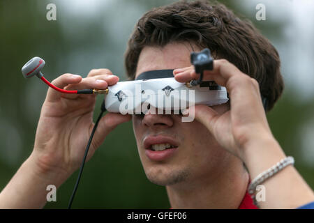 Drone pilot with glasses on its control - Stock Photo