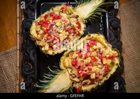 Fancy sweet whole pineapple half salsa South American appetizer - Stock Photo