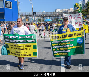 Anti-corruption protestors gather on Copacabana beach to vent their frustration at the current political situation - Stock Photo