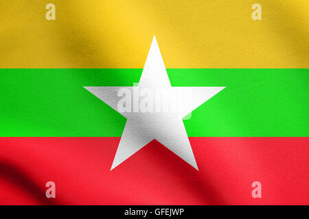 Flag of Myanmar waving in the wind with detailed fabric texture. Myanmar national flag. - Stock Photo