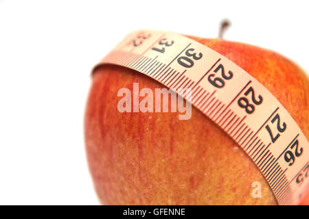 Diet concep Cutout of a tape measure wrapped around an apple on white background - Stock Photo
