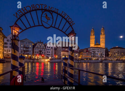 Pier Hotel Storchen old town center, river Limmat, Grossmunster and Limmatquai in Zurich at night,  Switzerland, - Stock Photo