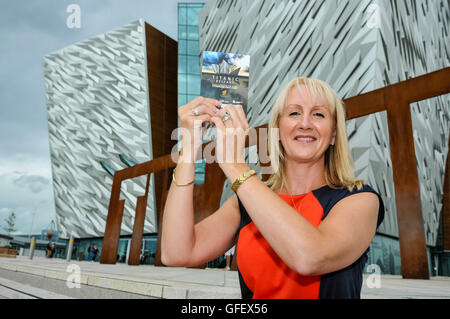 Belfast, Northern Ireland, 30th July 2013 - Titanic Belfast welcomes Co. Kildare woman Ciara Harmon as it's one - Stock Photo