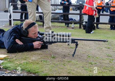 Ballykinlar, Northern Ireland. 2nd August 2013 - A Finnish Police officer fires a Remington 700P bolt-action sniper - Stock Photo