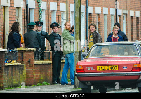 Belfast, Northern Ireland. 18 Dec 2014 - Actors dressed as Royal Ulster Constabulary (RUC) officers and Irish Republicans - Stock Photo