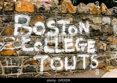 Graffiti saying 'Boston College Touts', referring to IRA members who took part in Boston College history project. - Stock Photo