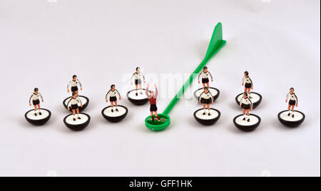 Subbuteo table football team players goalkeeper on a stick against a white background  colours of West Germany - Stock Photo