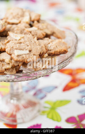 Cookies with apples on baking tray - Stock Photo