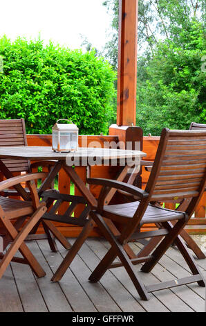 wooden garden chairs and table on decking stock photo - Garden Furniture On Decking
