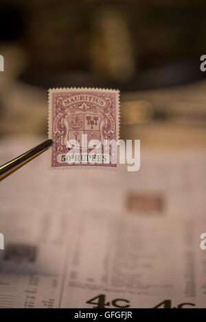 Stamp collecting as a pastime with rare and expensive stamps and High catalogue values like this 50 Rupee stamp - Stock Photo