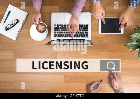 Patent License agreement    LICENSING man touch bar search and Two Businessman working at office desk and using - Stock Photo
