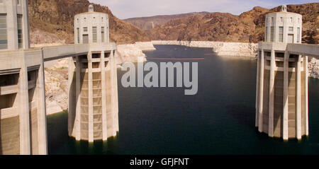 A panoramic view of the upstream side Hoover Dam, showing the Penstock Towers. - Stock Photo