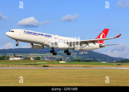 urich/Switzerland July10, 2016: Turkish Airliners Airbus A330 landing at Zurich Airport. - Stock Photo