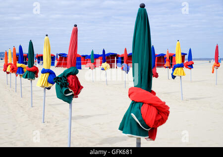 Colourful beach umbrellas on the famous beach of Deauville in France - Stock Photo