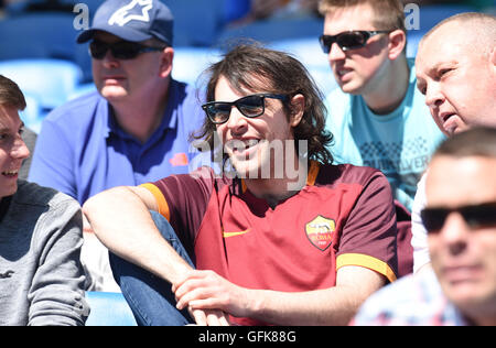 A Roma fan amongst Brighton fans during the Friendly match between Brighton and Hove Albion and Lazio at the American - Stock Photo