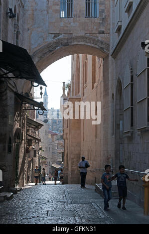 Jerusalem: children under the span of the Ecce Homo arch  which stands outside the Ecce Homo Church on Via Dolorosa - Stock Photo