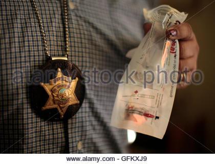 Orange County Deputy Probation Officer Erin Merritt Holds A Spoon ...