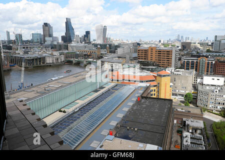 Solar panels on the roof of the Tate Modern Art Gallery and financial district viewed from Tate Extension London - Stock Photo