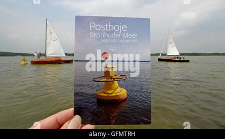Steinhude, Germany. 27th July, 2016. Skippers steering towards a mail buoy that is anchored in Steinhuder Meer lake - Stock Photo