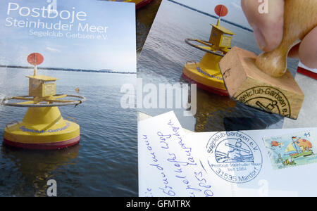 Steinhude, Germany. 27th July, 2016. Post cards with photos of the mail buoy that is anchored in Steinhuder Meer - Stock Photo