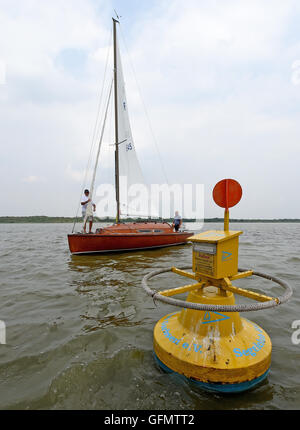 Steinhude, Germany. 27th July, 2016. Skippers throwing a post card into a mail buoy that is anchored in Steinhuder - Stock Photo