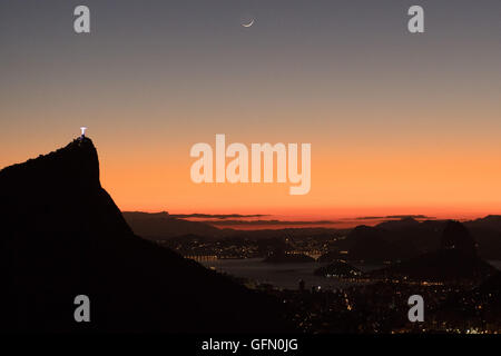 August. 01st Aug, 2016. Christ the Redeemer is seen during sunrise from the viewpoint Vista Chinesa in Rio de Janiero, - Stock Photo