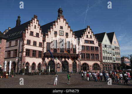 Tourists in front of the Frankfurt City Hall also known as the Romer at the Romerberg in Frankfurt am Main, Hesse, - Stock Photo