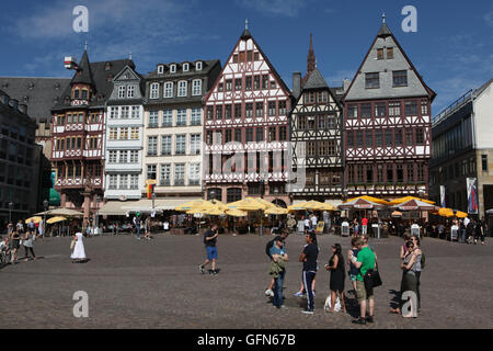 Tourists in front of the reconstructed half-timbered houses of the Ostzeile at the Romerberg in Frankfurt am Main, - Stock Photo