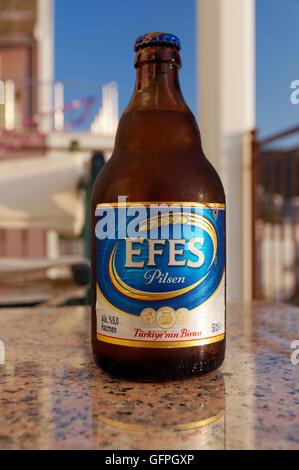 Bottle of Efes Pilsen beer, Turkey. - Stock Photo