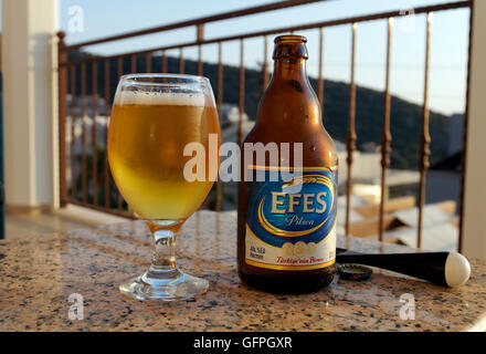 Bottle and glass of Efes Pilsen beer, Turkey. - Stock Photo