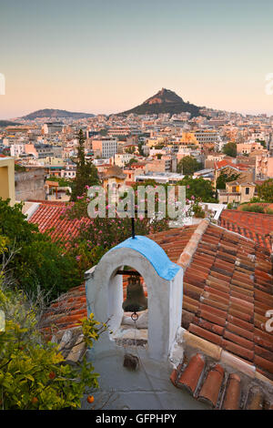 View of Lycabettus hill and a small Greek orthodox church in Anafiotika, Athens. - Stock Photo