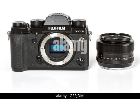 FUJIFILM X-T2, 24 megapixels, 4K video mirrorless camera with visible sensor f 35mm 1.4 fixed lens on white background - Stock Photo