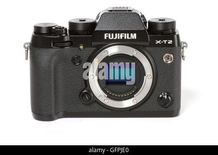 FUJIFILM X-T2, 24 megapixels, 4K video mirrorless camerawith visible sensor, from front on white background - Stock Photo