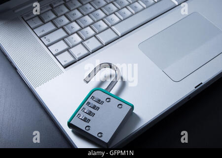 Padlock on laptop meaning protection from hacker and virus - Stock Photo