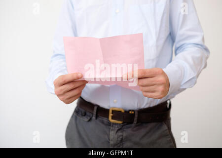 Business man reads the notice of job termination - Stock Photo