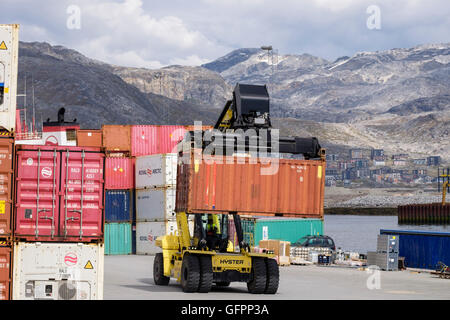 Hydraulic Hyster electric forklift truck lifting freight shipping container in port. Atlantic Harbour Nuuk Sermersooq - Stock Photo